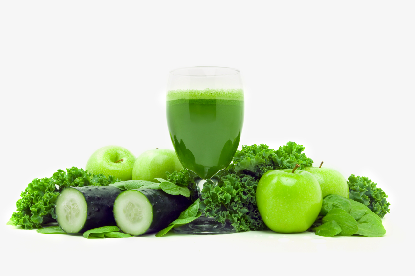 green detox juice surrounded by apples lettuce cucumber parsley herbs and spinach